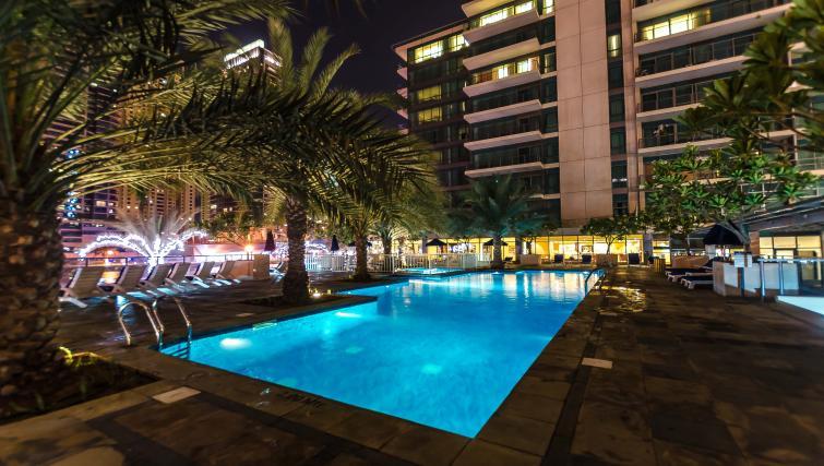 Swimming pool area at Nuran Marina Serviced Residences - Citybase Apartments