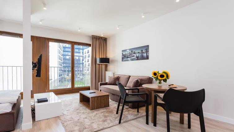 Living room at Platinum Residence Mokotow - Citybase Apartments