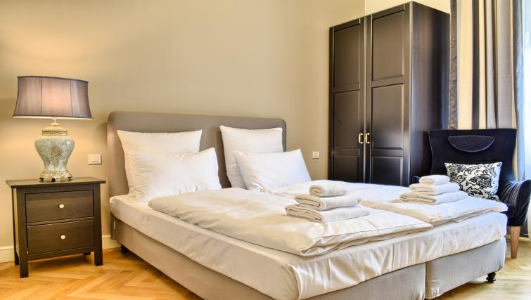 Stylish bedroom at Milosrdnych Apartments - Citybase Apartments