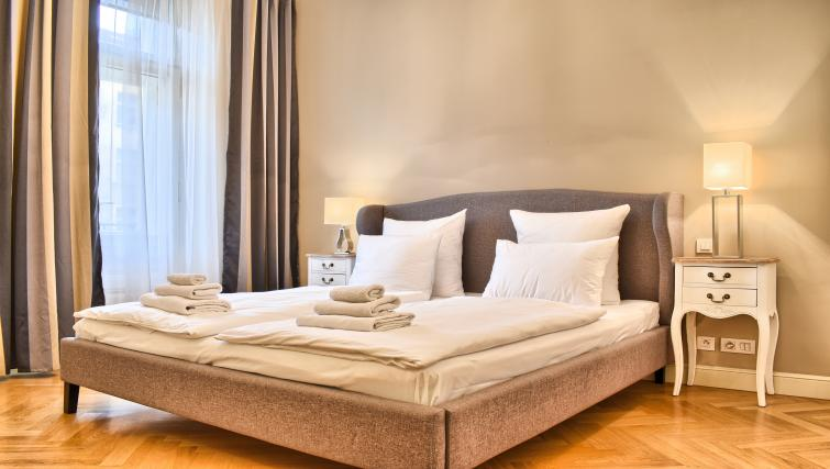 Bright bedroom at Milosrdnych Apartments - Citybase Apartments