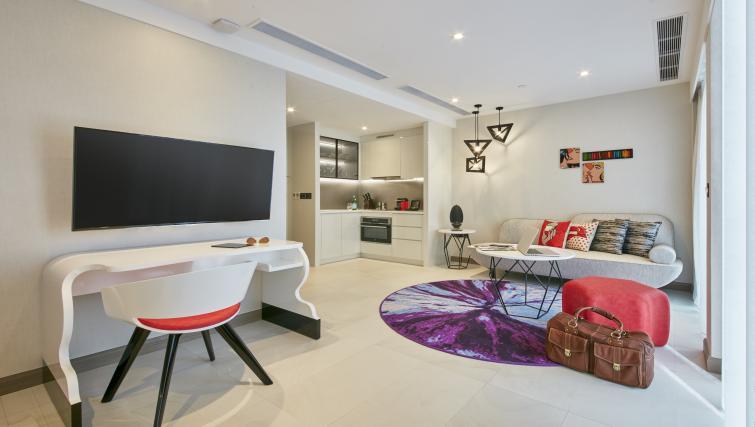 Living area at Oakwood Studios Singapore - Citybase Apartments