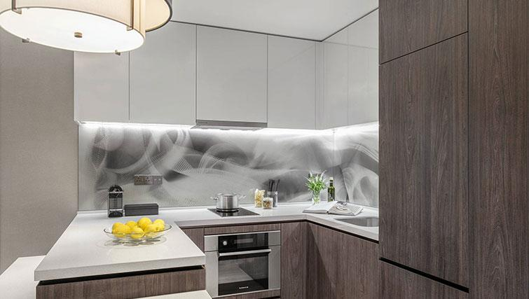 Equipped kitchen at Ascott Orchard Apartments, Singapore - Citybase Apartments