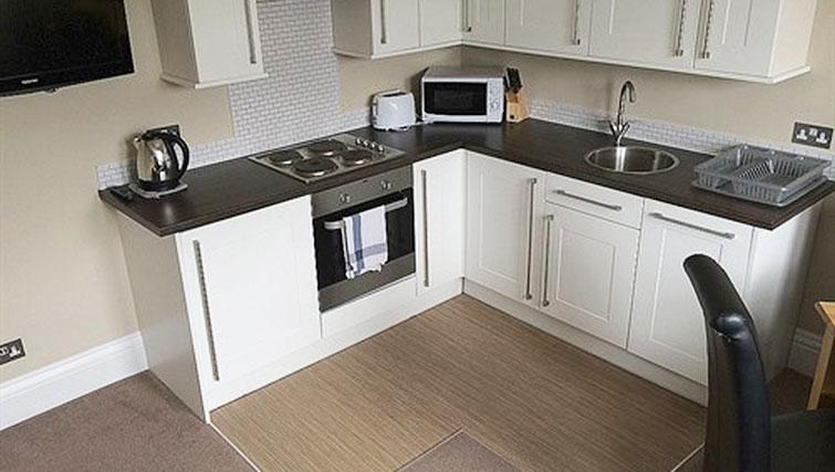 Equipped kitchen at Alum Chine Beach House - Citybase Apartments