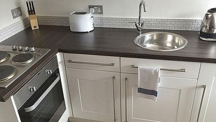 Tidy kitchen at Alum Chine Beach House - Citybase Apartments
