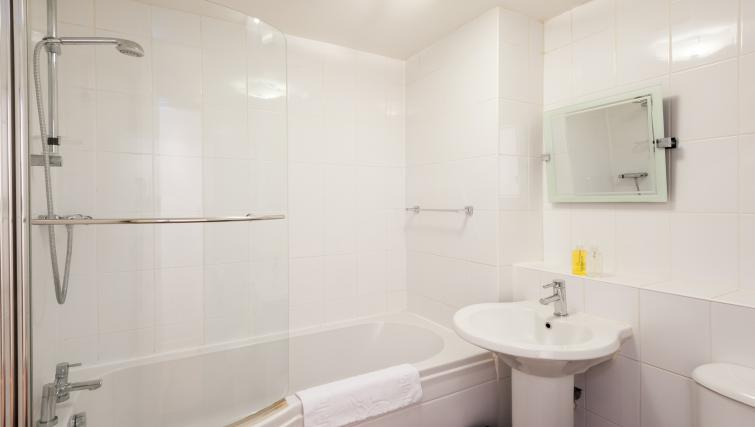 Bath with shower at Greyfriars Apartment - Citybase Apartments