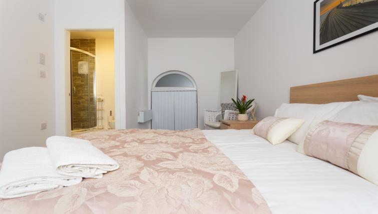 Bed at Nazarene Apartments - Citybase Apartments