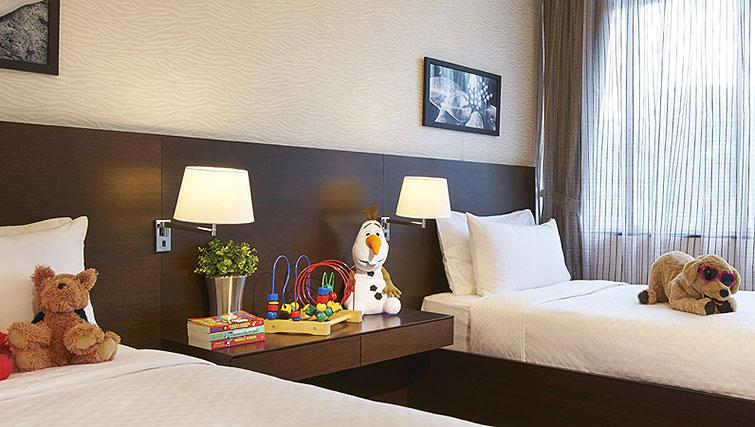 Twin beds at Orchard Scotts Residences, Singapore - Citybase Apartments