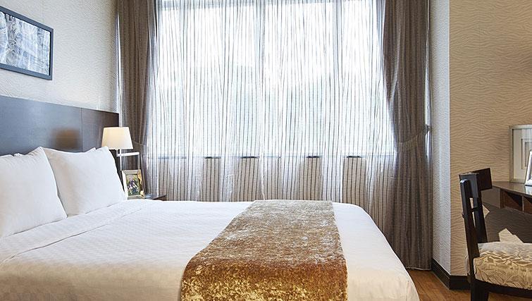 Stylish bedroom at Orchard Scotts Residences, Singapore - Citybase Apartments