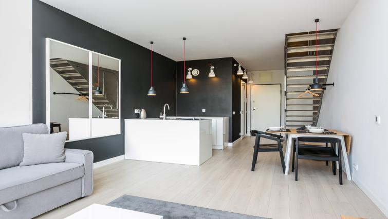 Basic kitchenette and dining table at Qbik Suites - Citybase Apartments