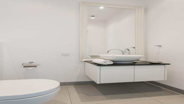 WC and sink at Qbik Suites - Citybase Apartments