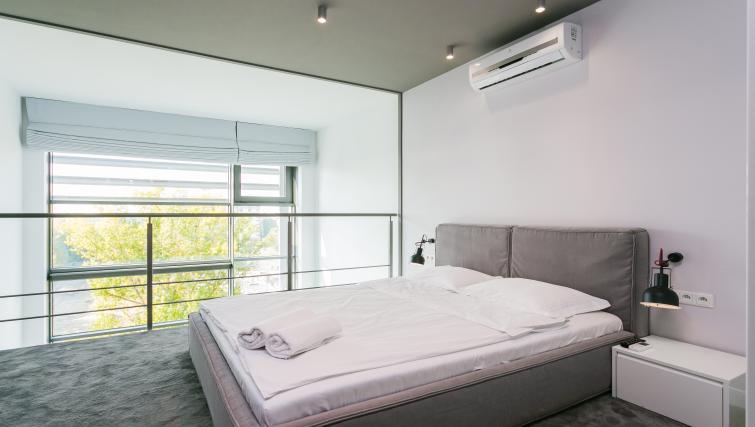 Double bed at Qbik Suites - Citybase Apartments