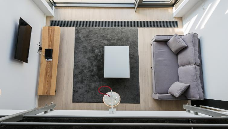 Overhead view of living area at Qbik Suites - Citybase Apartments