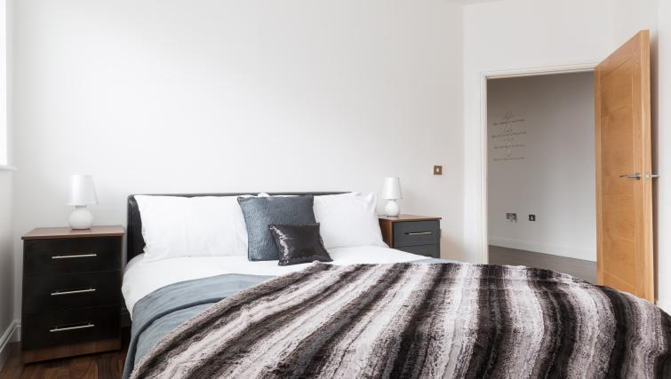 Double bed at The Mint Apartments - Citybase Apartments