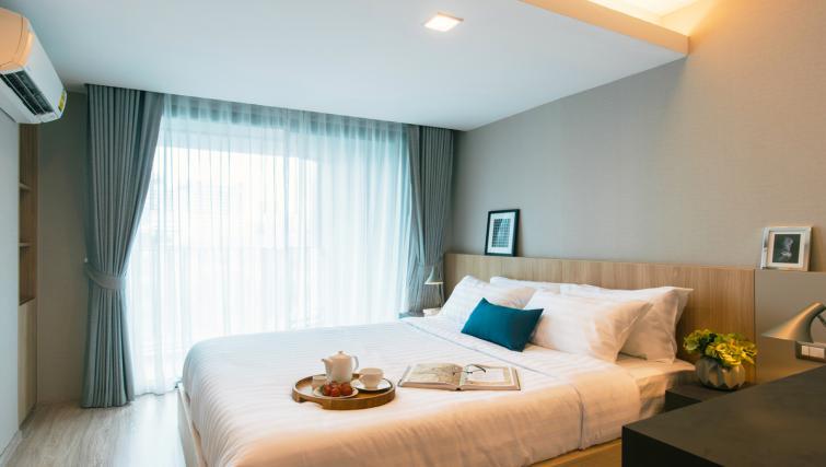 Bed at Somerset Ekamai Apartments - Citybase Apartments