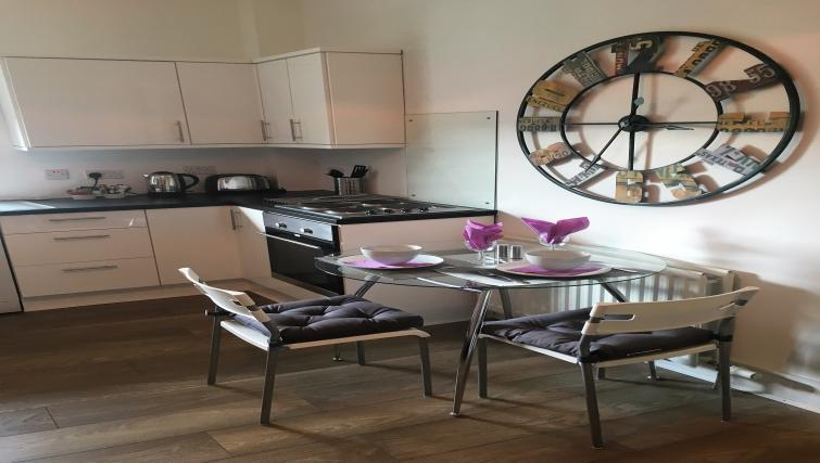 Dining table at Cross View Apartment - Citybase Apartments