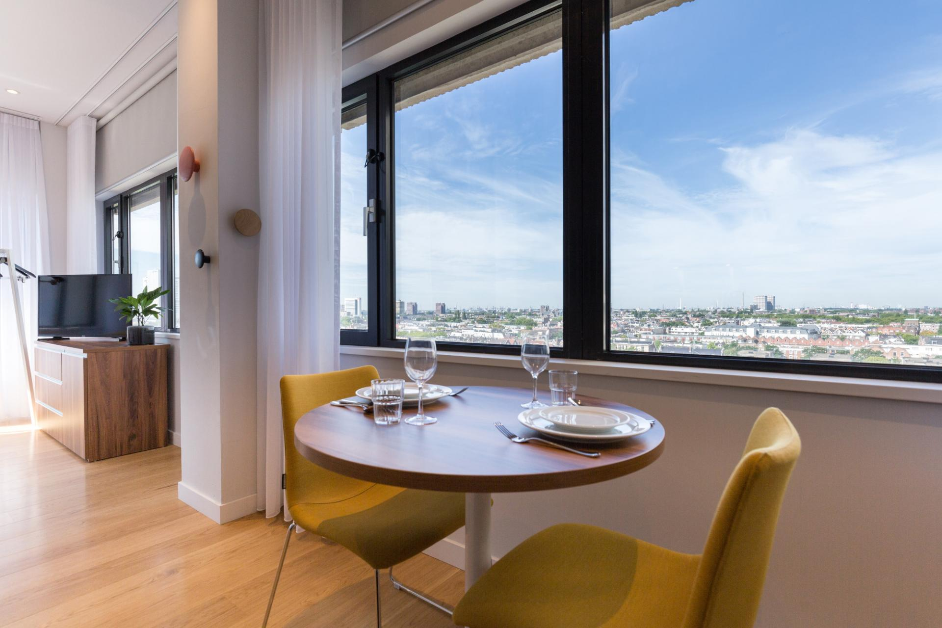 Dining table at Premier Suites Plus Rotterdam - Citybase Apartments
