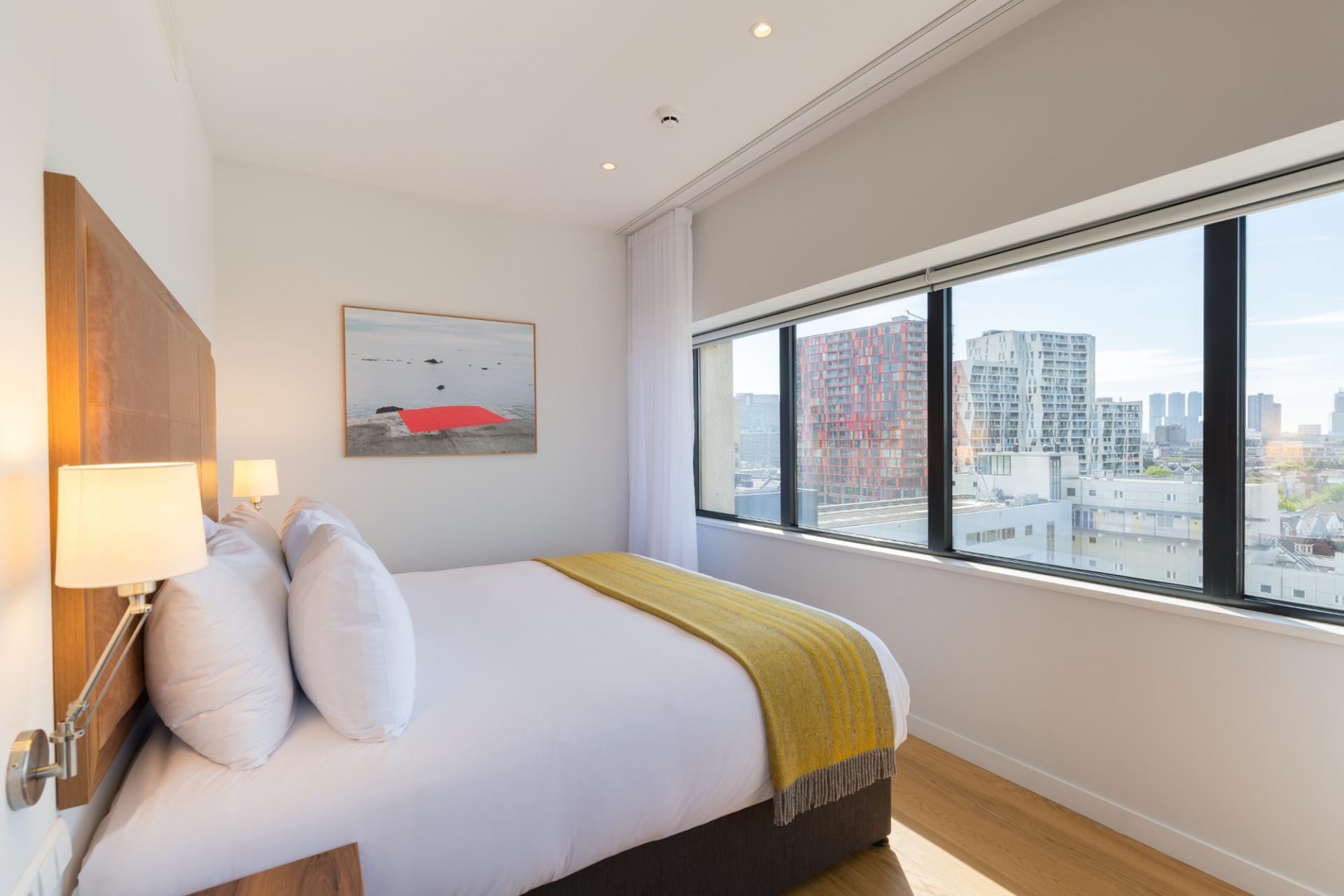 Bedroom at Premier Suites Plus Rotterdam - Citybase Apartments