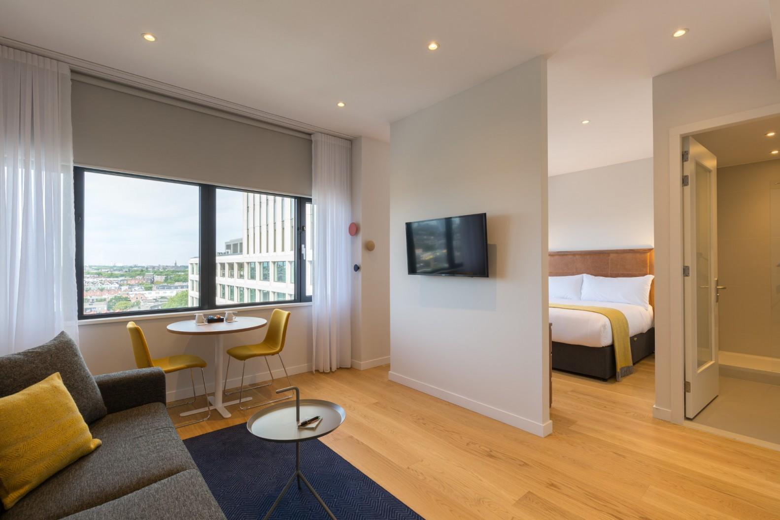 Living room at Premier Suites Plus Rotterdam - Citybase Apartments