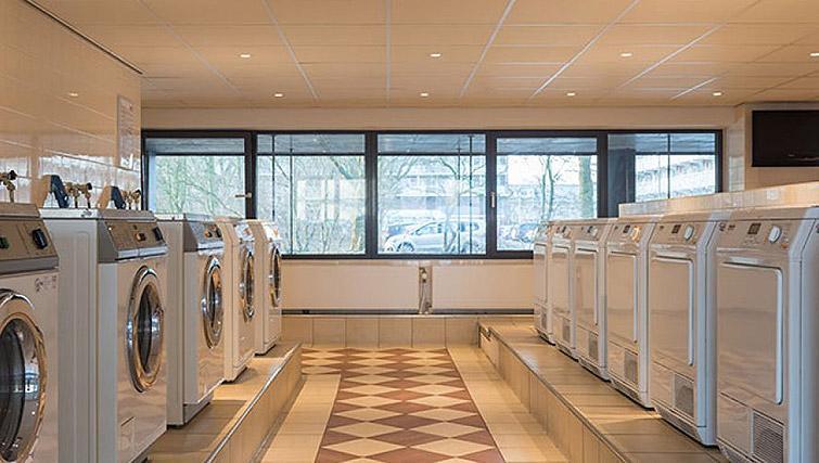 Communal laundry at Htel Amstelveen, Amsterdam - Citybase Apartments