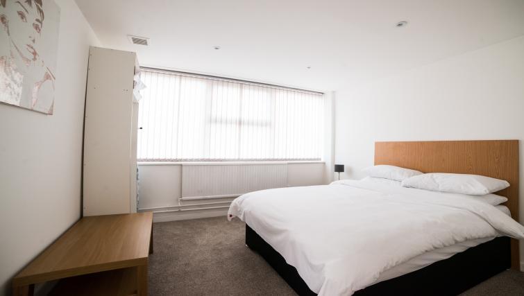 Bed at Keswick House Apartments - Citybase Apartments
