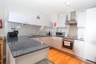 Modern kitchen at Ingram Apartments, Merchant City, Glasgow - Citybase Apartments