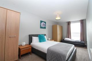 Spacious bedroom at Ingram Apartments, Merchant City, Glasgow - Citybase Apartments