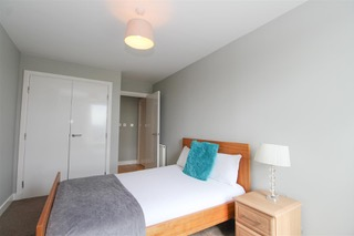 Large bedroom at Ingram Apartments, Merchant City, Glasgow - Citybase Apartments