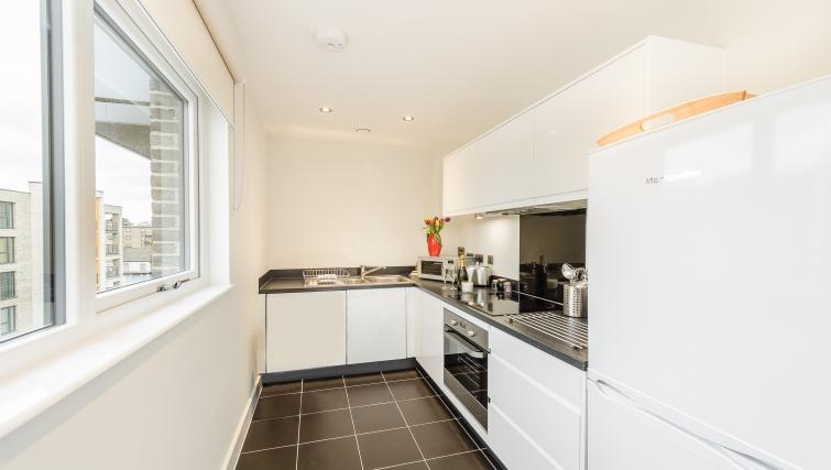 Equipped kitchen at Flying Butler Colindale Apartments - Citybase Apartments