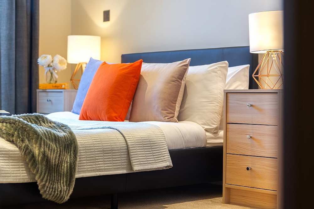 Comfortable bedroom at Canary Gateway - Citybase Apartments