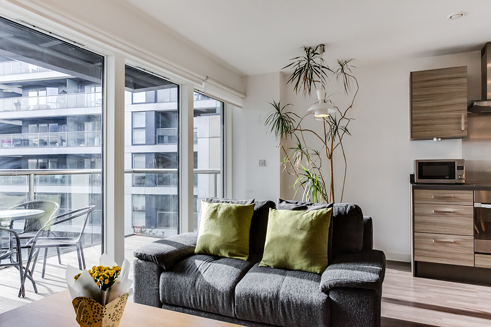 Living room at Dance Square Apartments - Citybase Apartments