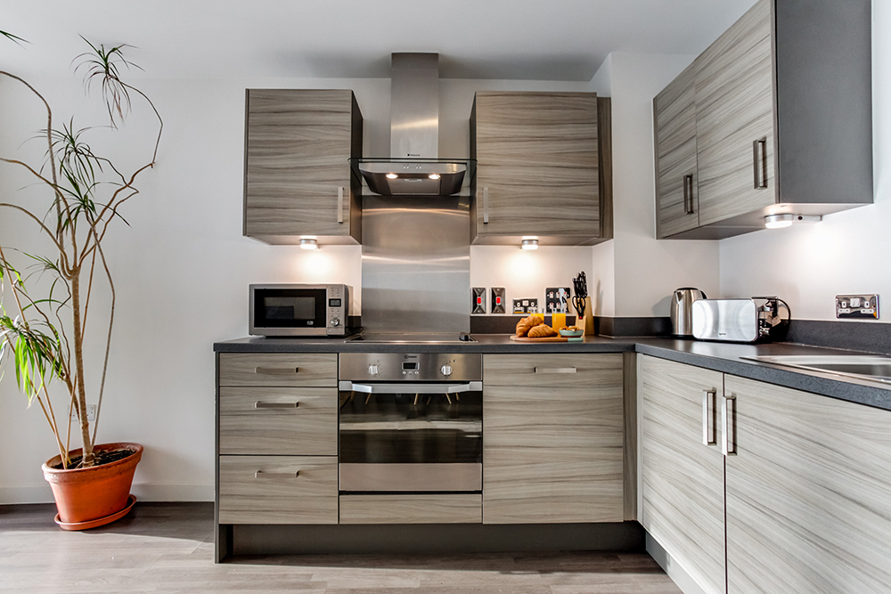 Kitchen at Dance Square Apartments - Citybase Apartments