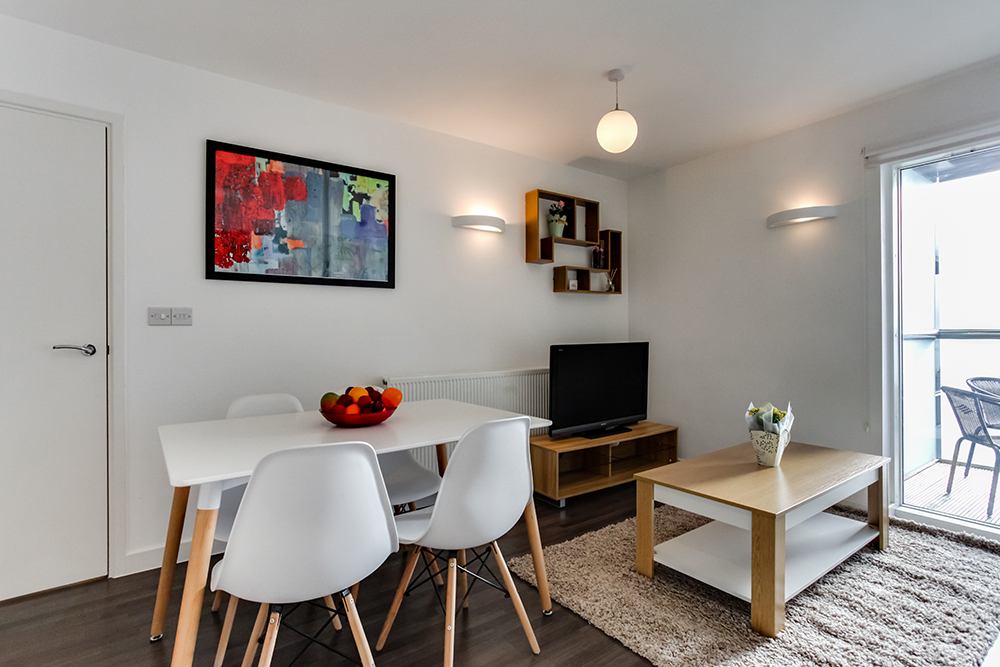 Dining table at Dance Square Apartments - Citybase Apartments