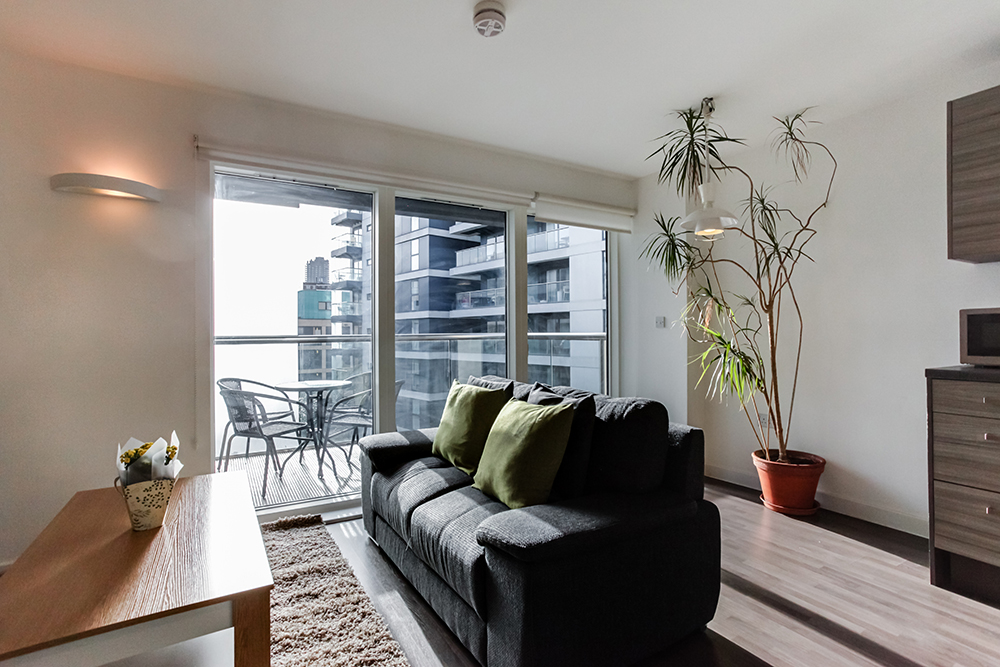 Bright living area at Dance Square Apartments - Citybase Apartments