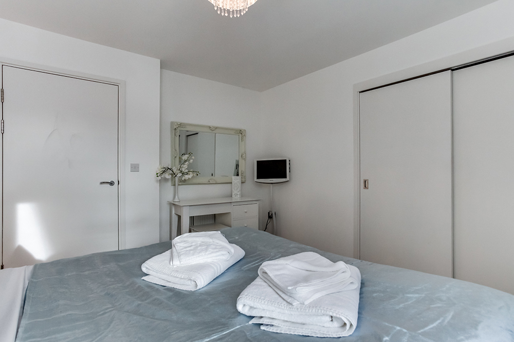 Spacious bedroom at Dance Square Apartments - Citybase Apartments