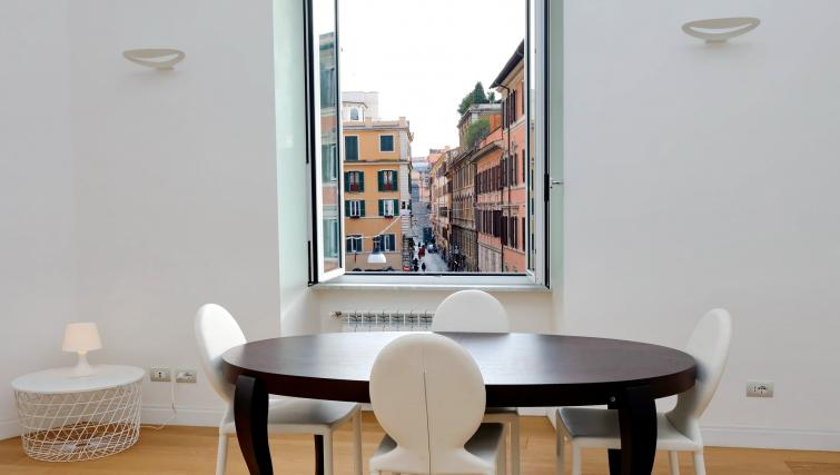 Dining area at Tritone Apartment - Citybase Apartments