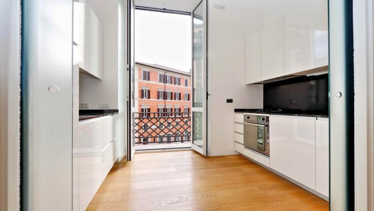 Kitchen at Tritone Apartment - Citybase Apartments