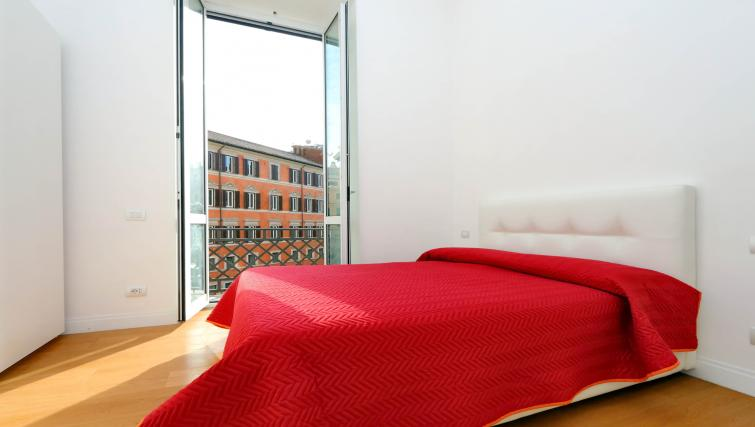 Bed at Tritone Apartment - Citybase Apartments