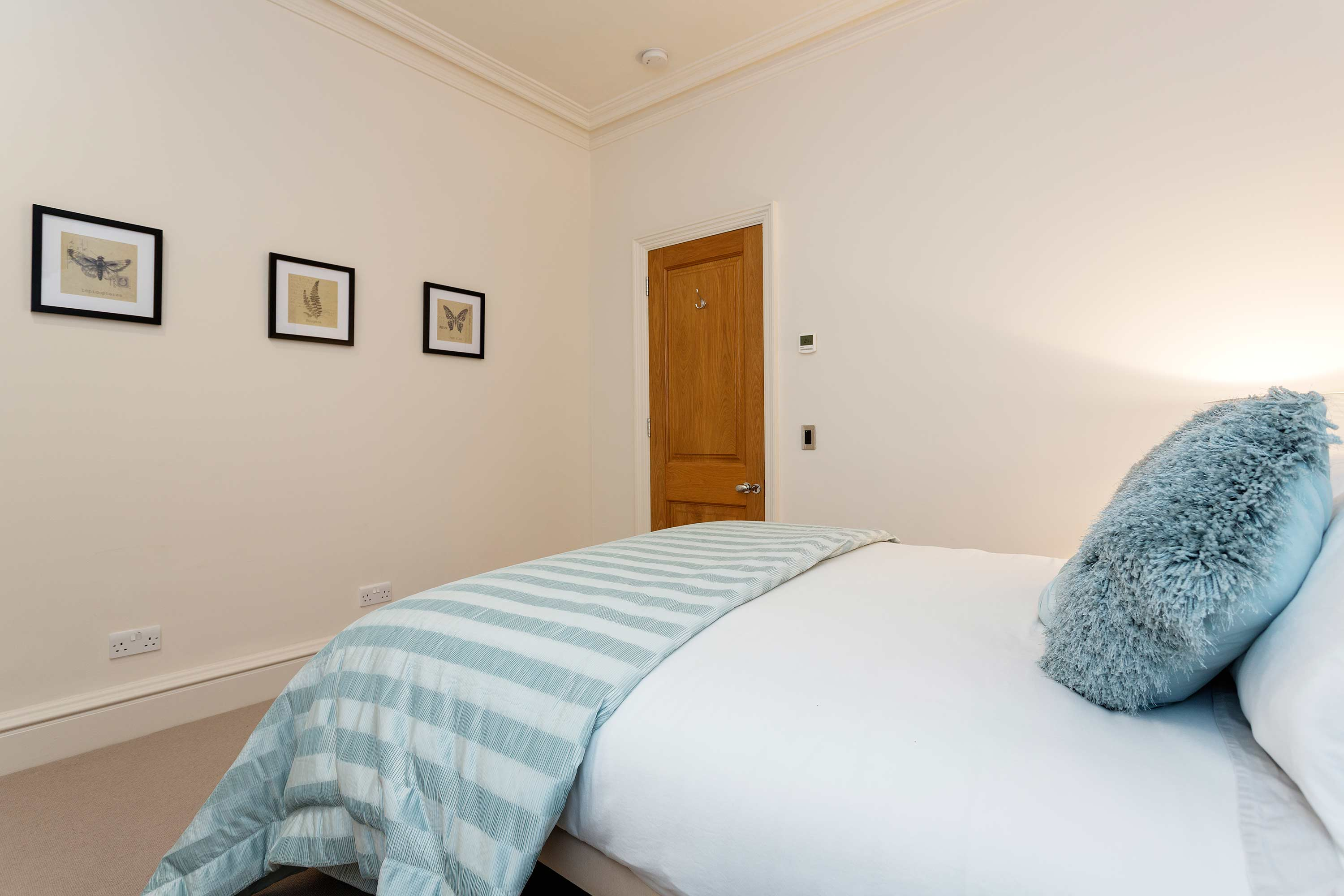 Charming bedroom at Redcliffe Retreat Apartment - Citybase Apartments