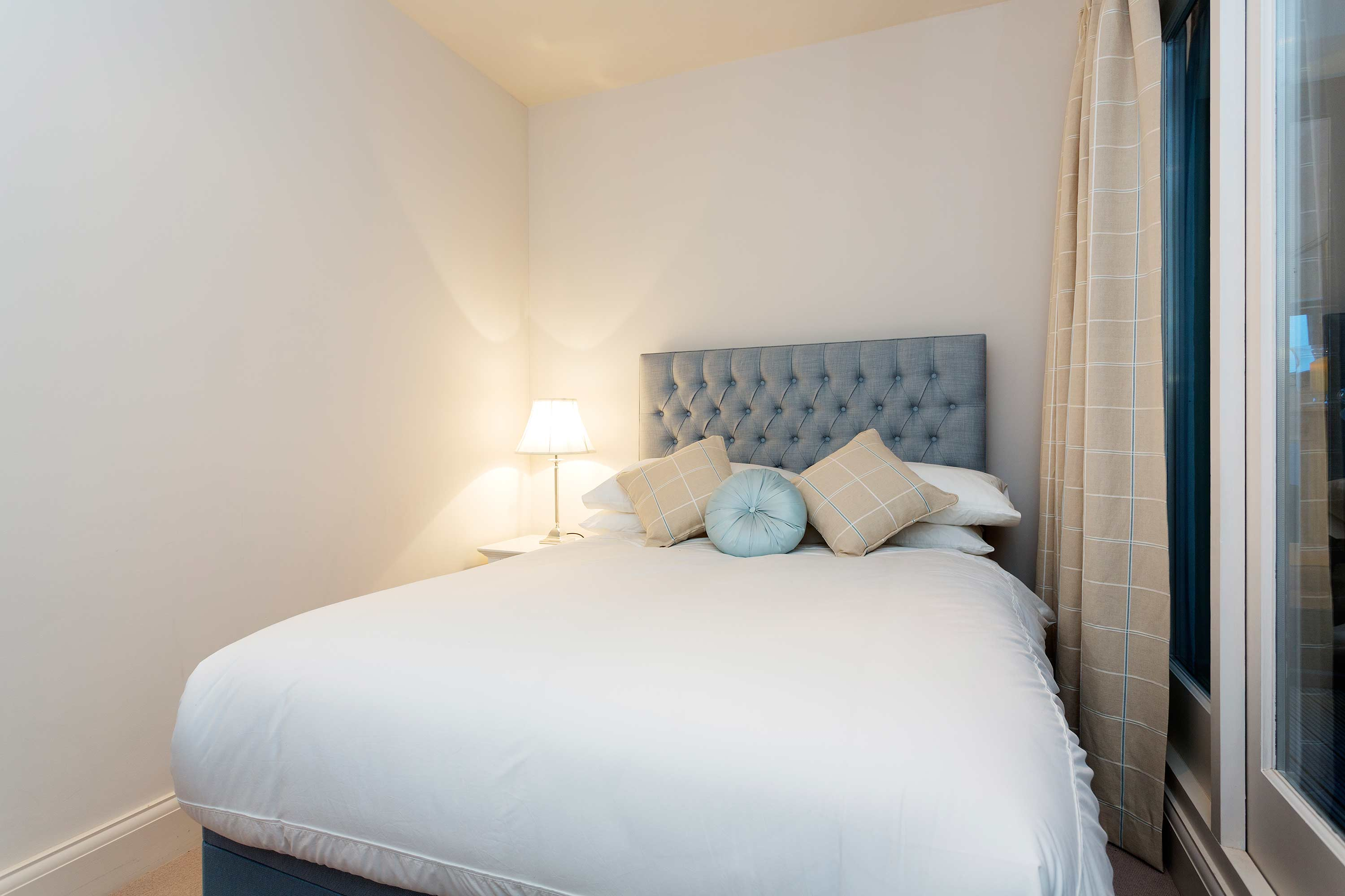 Double bed at Redcliffe Retreat Apartment - Citybase Apartments