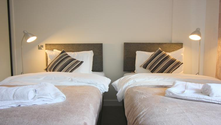 Modern bedroom at the The Station Suite - Citybase Apartments