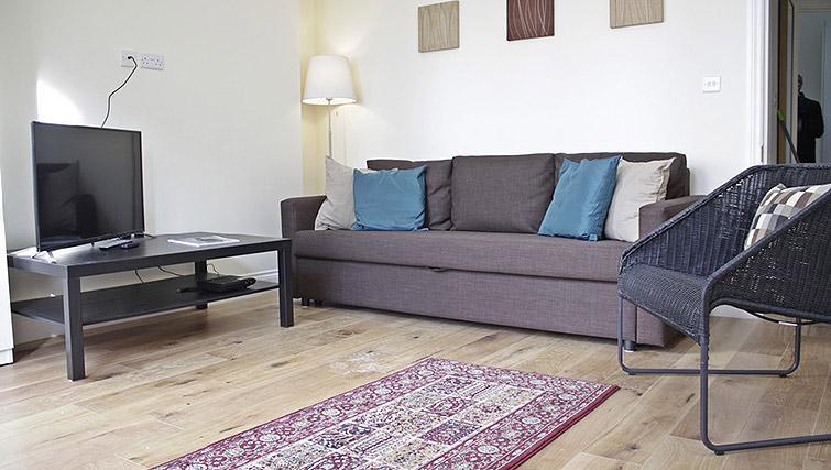 Sofa at Oxford Gardens Apartments - Citybase Apartments