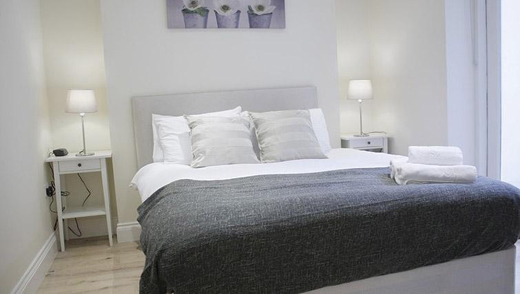 Comfy bed at Oxford Gardens Apartments - Citybase Apartments