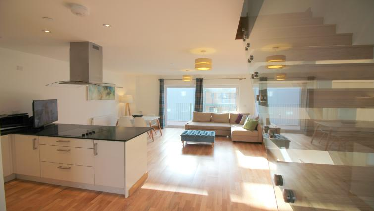 Spacious living area at Peymans Grand Central Apartments - Citybase Apartments