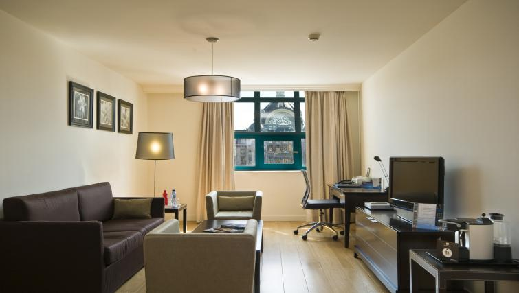 Stylish living area at Radisson Blu Astrid Antwerp Suites - Citybase Apartments