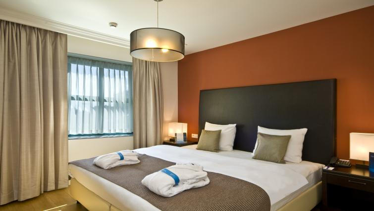 Bed at Radisson Blu Astrid Antwerp Suites - Citybase Apartments