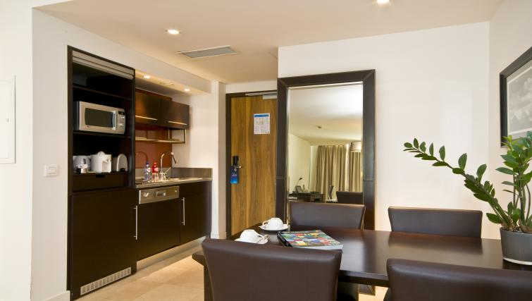 Kitchen and dining area at Radisson Blu Astrid Antwerp Suites - Citybase Apartments