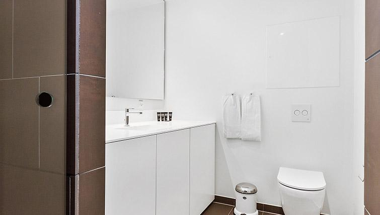 White bathroom at Stay Seaport Apartments - Citybase Apartments