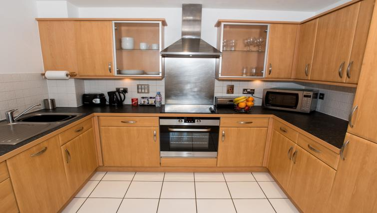Fully equipped kitchen at Riverside House Apartments - Citybase Apartments