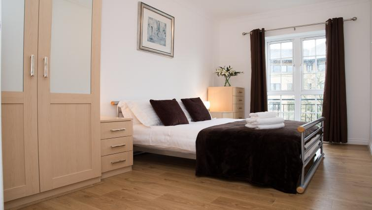 Bright bedroom at Riverside House Apartments - Citybase Apartments