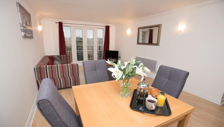 Dining table and chairs at Riverside House Apartments - Citybase Apartments